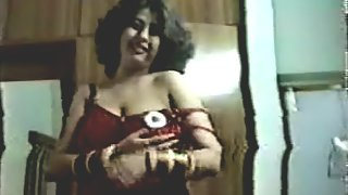 Indian wife teasing her hubby in red nighty