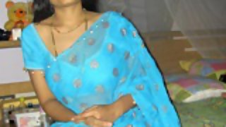 Indian wife aprita in blue saree stripping off in bedroom