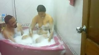 married Indian couple taking shower in home jacuzzi